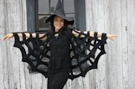 """<p>Whether it's for a girl little or a big, this bewitching, simple-to-make spiderweb cape will be the focal point of any Halloween costume. Top off the look with a peaked hat or a big fake spider on the back of the cape for extra fun.</p><p><strong>Get the tutorial at <a href=""""https://www.deliacreates.com/no-sew-halloween-spiderweb-cape-tutorial/"""" rel=""""nofollow noopener"""" target=""""_blank"""" data-ylk=""""slk:Delia Creates"""" class=""""link rapid-noclick-resp"""">Delia Creates</a>.</strong></p><p><a class=""""link rapid-noclick-resp"""" href=""""https://www.amazon.com/Tijeras-Singer-pulgadas-comodidad-paquete/dp/B000YZ8RGA/ref=asc_df_B000YZ8RGA/?tag=syn-yahoo-20&ascsubtag=%5Bartid%7C10050.g.23785711%5Bsrc%7Cyahoo-us"""" rel=""""nofollow noopener"""" target=""""_blank"""" data-ylk=""""slk:SHOP FABRIC SCISSORS"""">SHOP FABRIC SCISSORS</a><br></p>"""