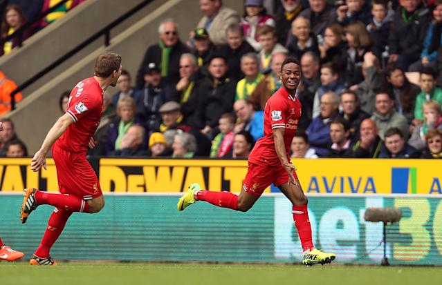 Liverpool's Raheem Sterling, right, celebrates scoring the opening goal during their English Premier League match against Norwich City at Carrow Road, Norwich, eastern England, Sunday April 20, 2014. (AP Photo/PA, Chris Radburn)