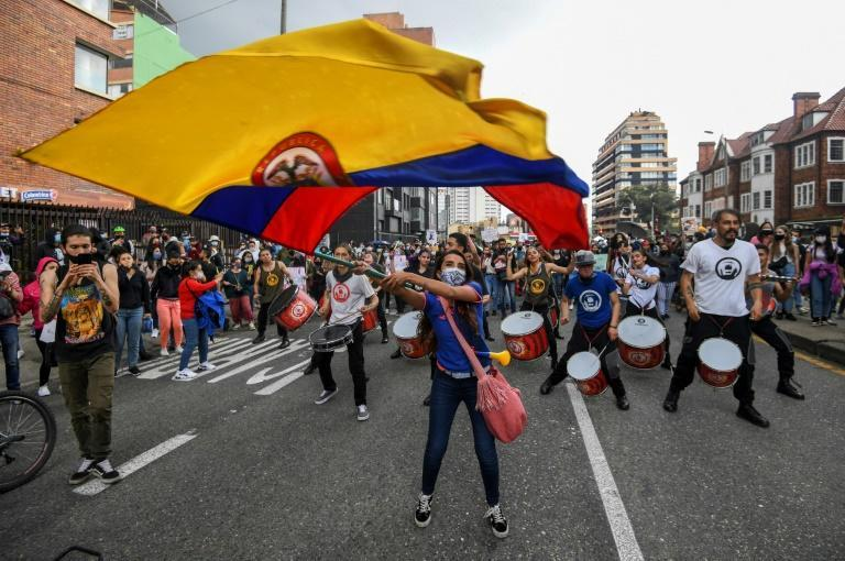 A woman waves a Colombian national flag during an anti-government protest