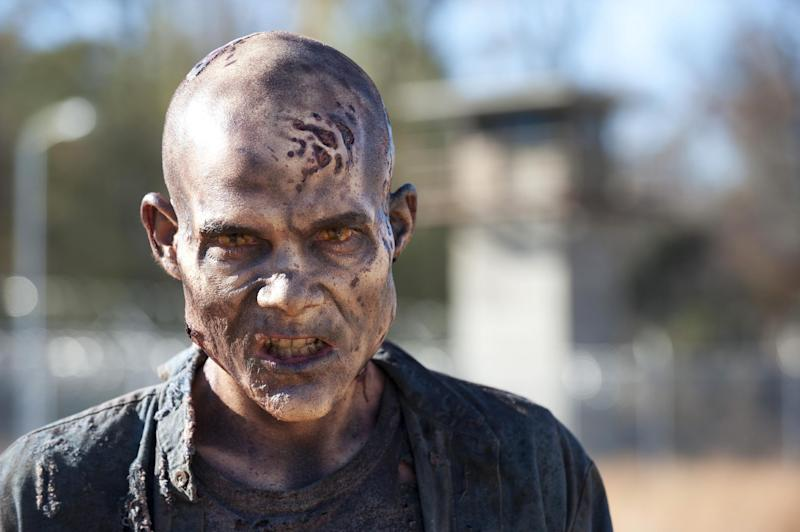 "FILE - This file publicity photo released by AMC shows a walker in Episode 16, ""Welcome to the Tombs,"" from Season 3 of the TV series, ""The Walking Dead."" Violent dramas on the broadcast networks carry milder parental cautions than cable shows like ""The Walking Dead"" but can equal them in graphic gore, a failure of the TV ratings system, according to a Parents Television Council study released Monday, Dec. 9, 2013. (AP Photo/AMC, Gene Page, File)"