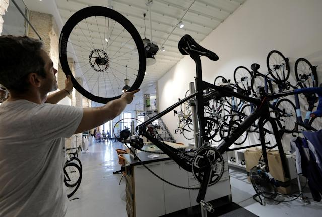 The Cafe du Cycliste bike shop in Nice, France. Bike shops are repositioning themselves as cafes, bars, and community spaces to stay alive. (Source: Reuters)