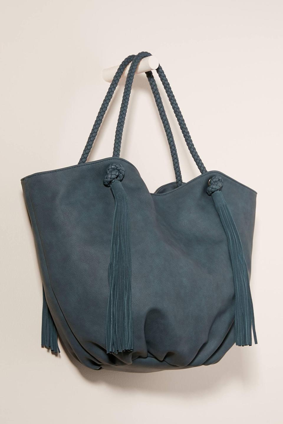 """<p>This <a href=""""https://www.popsugar.com/buy/Morgan-Tasseled-Tote-Bag-537120?p_name=Morgan%20Tasseled%20Tote%20Bag&retailer=anthropologie.com&pid=537120&price=88&evar1=fab%3Aus&evar9=45623846&evar98=https%3A%2F%2Fwww.popsugar.com%2Ffashion%2Fphoto-gallery%2F45623846%2Fimage%2F47066459%2FMorgan-Tasseled-Tote-Bag&list1=shopping%2Caccessories%2Cbags%2Cworkwear&prop13=mobile&pdata=1"""" class=""""link rapid-noclick-resp"""" rel=""""nofollow noopener"""" target=""""_blank"""" data-ylk=""""slk:Morgan Tasseled Tote Bag"""">Morgan Tasseled Tote Bag</a> ($88) comes in a ton of fun color choices.</p>"""