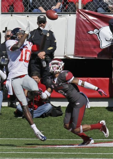 Mississippi wide receiver Vince Sanders (10) catches a touchdown pass over Arkansas cornerback Tevin Mitchel (8) during the first half of an NCAA college football game in Little Rock, Ark., Saturday, Oct. 27, 2012. (AP Photo/Danny Johnston)