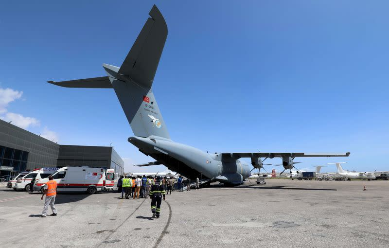 A Turkish military cargo plane prepares to evacuate victims of the car bomb explosion at the Afgoye junction, for specialised treatment, at the Aden Abdulle International Airport in Mogadishu