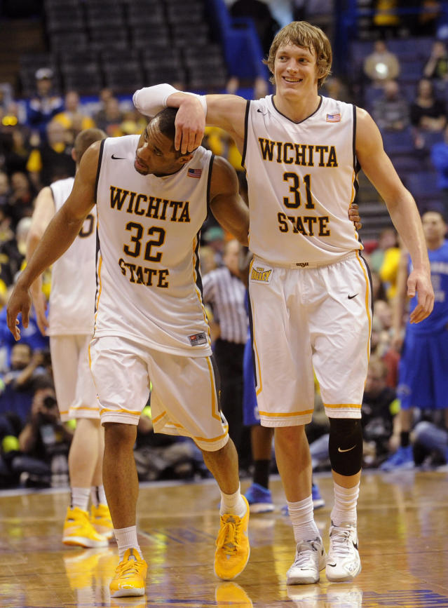 Wichita State's Ron Baker (31) and Tekele Cotton (32) celebrate late in the second half of an NCAA college basketball game against Indiana State for the championship of the Missouri Valley Conference Sunday, March 9, 2014, in St. Louis. (AP Photo/Bill Boyce)