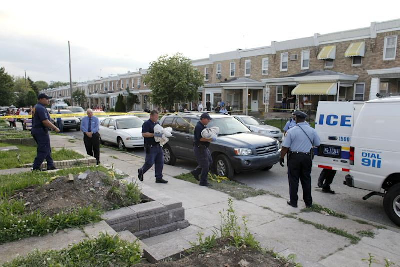 A crime scene unit members carry the bodies of toddler twins from a home in Northeast Philadelphia where they were found dead and their mother taken into custody on Thursday May 24, 2012. Police say the 18-month-old boy and girl appear to have died of suffocation. Police say their 41-year-old mother attempted to take her own life by slitting her wrists and they believe she gave some kind of prescription pills to her 4-year-old daughter. The 4-year-old girl is hospitalized. (AP Photo/ Joseph Kaczmarek)