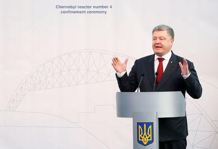 Ukrainian President Petro Poroshenko delivers a speech during a ceremony to unveil the 'New Safe Confinement' (NSC) arch, that will block radiation from the damaged reactor at the Chernobyl nuclear power plant, Ukraine, November 29, 2016. REUTERS/Gleb Garanich