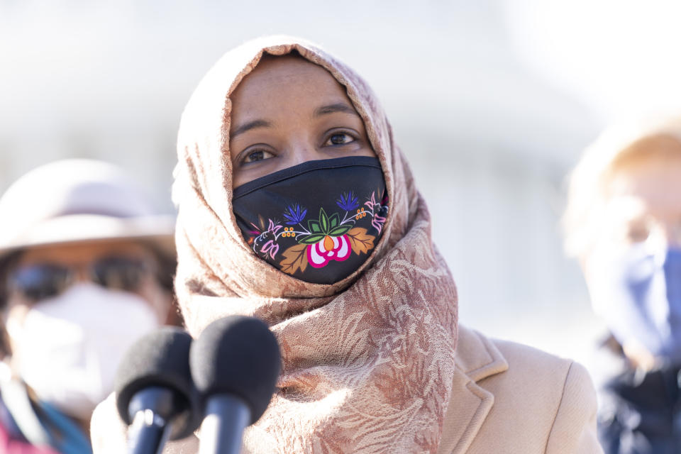 Rep. Ilhan Omar speaks into a microphone