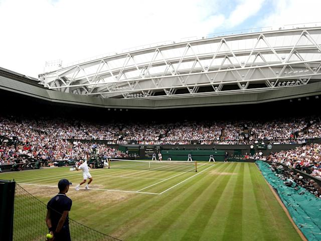 A general view of centre court as Roger Federer of Switzerland serves: Getty Images