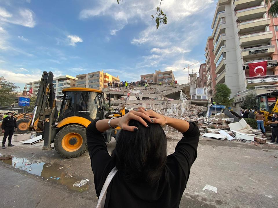 IZMIR, TURKEY - OCTOBER 30: A woman reacts as search and rescue works continue at debris of a building after a quake shook Turkey's Aegean Sea coast, in Izmir, Turkey on October 30, 2020. (Photo by Lokman Ilhan/Anadolu Agency via Getty Images)