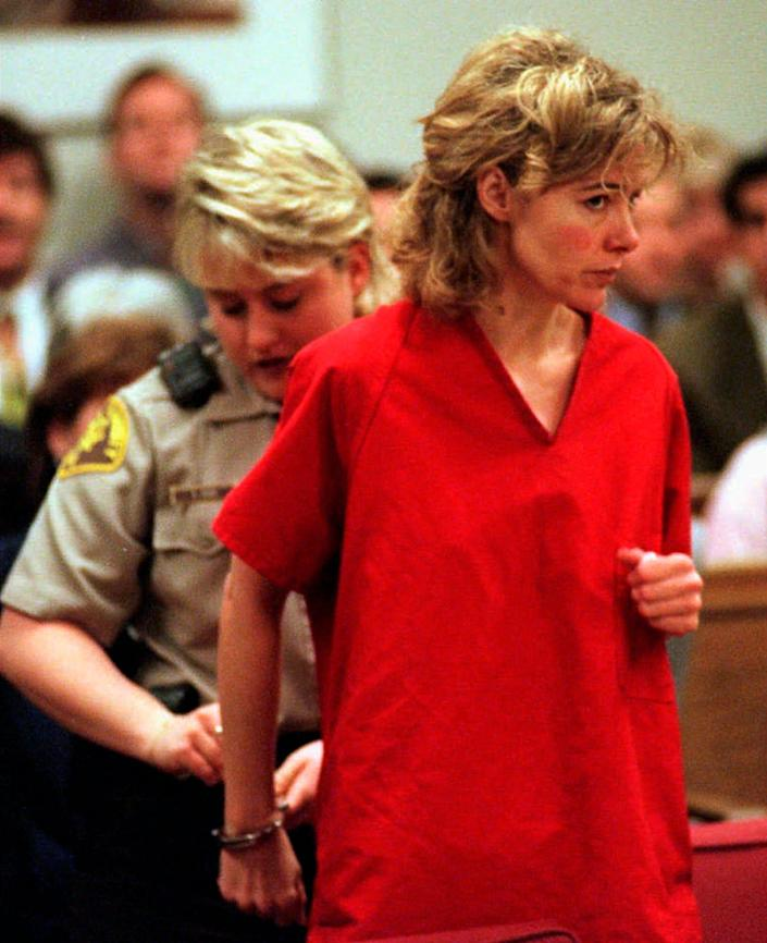 In this Feb. 6, 1998 photo, former grade school teacher Mary Kay Letourneau has her handcuffs removed at the start of a hearing in Seattle, where she was re-sentenced to 7 1/2 years in jail for violating her parole.