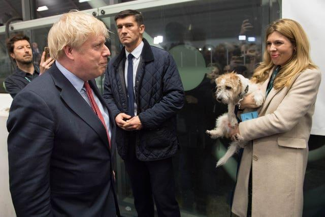 Prime Minister Boris Johnson with partner Carrie Symonds and dog Dilyn at the count for the Uxbridge & Ruislip South constituency (Stefan Rousseau/PA)