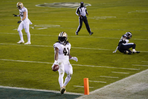New Orleans Saints' Alvin Kamara runs for a touchdown during the second half of an NFL football game against the Philadelphia Eagles, Sunday, Dec. 13, 2020, in Philadelphia. (AP Photo/Chris Szagola)