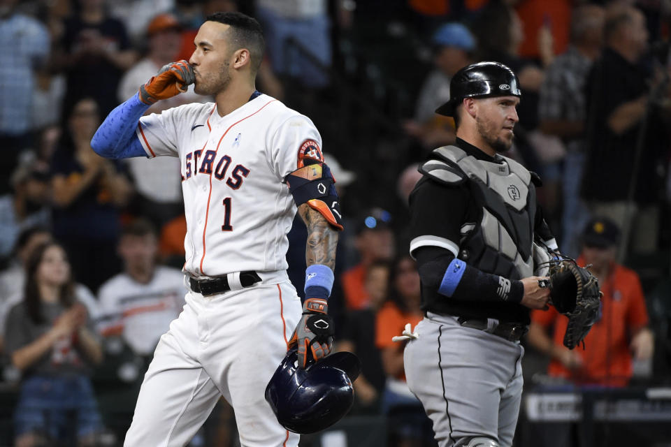 Houston Astros' Carlos Correa (1) celebrates his solo home run during the fourth inning of a baseball game against the Chicago White Sox, Sunday, June 20, 2021, in Houston. (AP Photo/Eric Christian Smith)