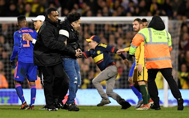 Soccer Football - International Friendly - Australia vs Colombia - Craven Cottage, London, Britain - March 27, 2018 Stewards apprehend pitch invaders Action Images via Reuters/Tony O'Brien