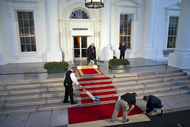 """White House staff prepare for the arrival of French President François Hollande for a State Dinner hosted by President Barack Obama at the North Portico of the White House on Tuesday, Feb. 11, 2014, in Washington. Lauding the """"enduring alliance"""" between the United States and France, Obama on Tuesday welcomed Hollande to the White House for a lavish state visit. The highly anticipated trip is taking place amid swirling speculation on both sides of the Atlantic about problems in Hollande's personal life. (AP Photo/ Evan Vucci)"""