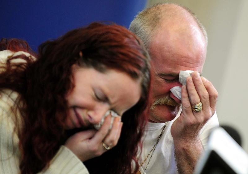 """FILE - In this May 16, 2012 file photo, Mick Philpott, right, and wife Mairead react during a news conference at Derby Conference Centre following a fire at their home  which claimed the lives of six of his children, Derby, England. A judge sentenced the Mick Philpott father of six children who died in a house fire to a minimum of 15 years in prison Thursday April 4, 2013, after describing him as the """"driving force"""" behind the blaze.  Judge Kathryn Thirlwall leveled most of the responsibility for the fire on Mick Philpott, describing him as a dangerous man. His wife, Mairead, Philpott received 17 years for manslaughter as did a family friend, Paul Mosley, who helped in the plot.   (AP Photo/PA, Rui Vieira, File) UNITED KINGDOM OUT, NO SALES, NO ARCHIVE"""