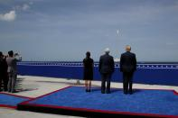 FILE PHOTO: U.S. President Trump watches the launch of a SpaceX Falcon 9 rocket and Crew Dragon spacecraft, from Cape Canaveral, Florida