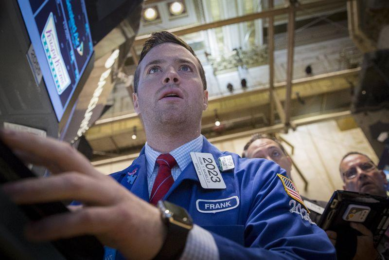 Masiello works at a trading post on the floor of the New York Stock Exchange