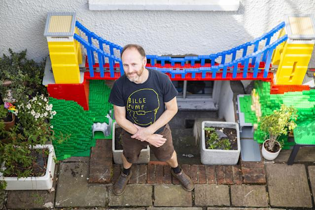 John Ford with the Duplo bridge that is a replica of the Clifton Suspension Bridge. (SWNS)