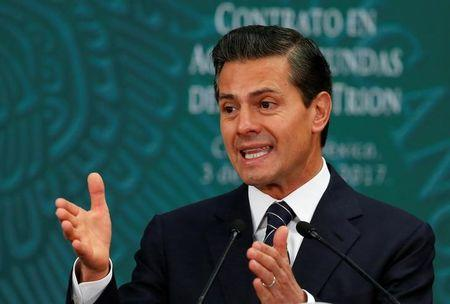 Mexico's President Enrique Pena Nieto addresses the audience during the first-deep water contract ceremony between Pemex and BHP Billiton in Mexico City, Mexico