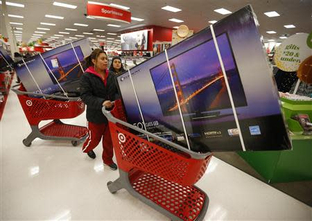 Holiday shoppers line up with discounted television sets at the Target retail store in Chicago, Illinois in this file photo taken November 28, 2013. REUTERS/Jeff Haynes