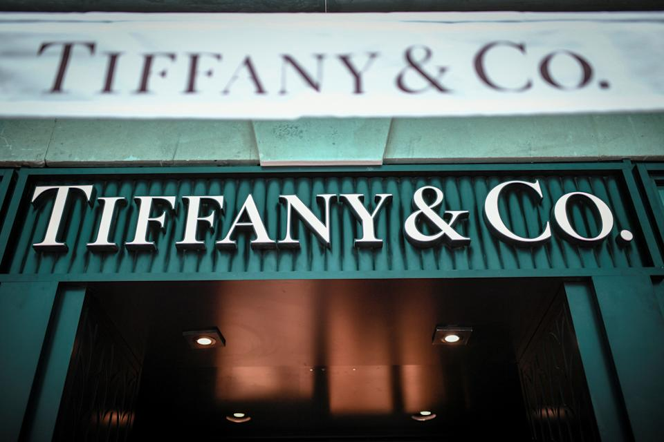 A picture taken on October 29, 2019 shows the US luxury shop Tiffany&Co.'s logo outside a Tiffany&Co. Shop in Paris. - French luxury giant LVMH said on October 28, 2019 it was exploring a takeover of US jewellers Tiffany, most famous for its fine diamonds and luxury wedding and engagement rings. (Photo by STEPHANE DE SAKUTIN / AFP) (Photo by STEPHANE DE SAKUTIN/AFP via Getty Images)
