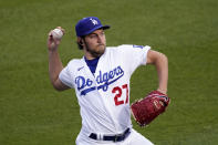 Los Angeles Dodgers starting pitcher Trevor Bauer warms up prior to a baseball game against the Colorado Rockies Tuesday, April 13, 2021, in Los Angeles. (AP Photo/Mark J. Terrill)