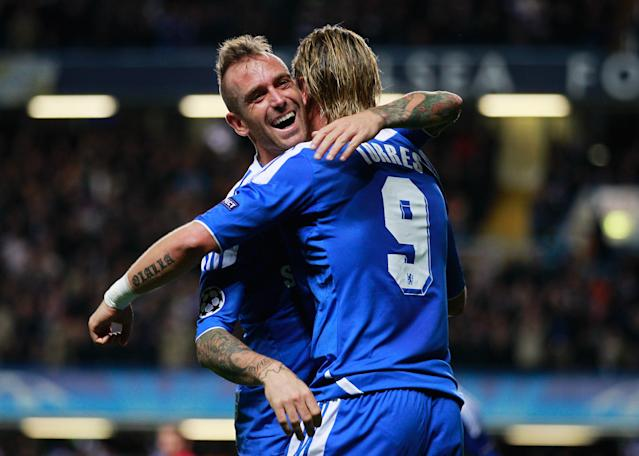 LONDON, ENGLAND - OCTOBER 19: Fernando Torres of Chelsea (9) celebrates with Raul Meireles as he scores their third goal during the UEFA Champions League group E match between Chelsea and Genk at Stamford Bridge on October 19, 2011 in London, England. (Photo by Paul Gilham/Getty Images)