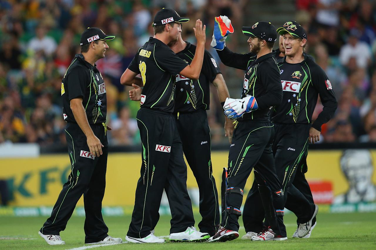 SYDNEY, AUSTRALIA - FEBRUARY 02:  James Muirhead of Australia is congratulated by his team after taking the catch to dismiss Alex Hales of England during game three of the International Twenty20 series between Australia and England at ANZ Stadium on February 2, 2014 in Sydney, Australia.  (Photo by Mark Kolbe/Getty Images)