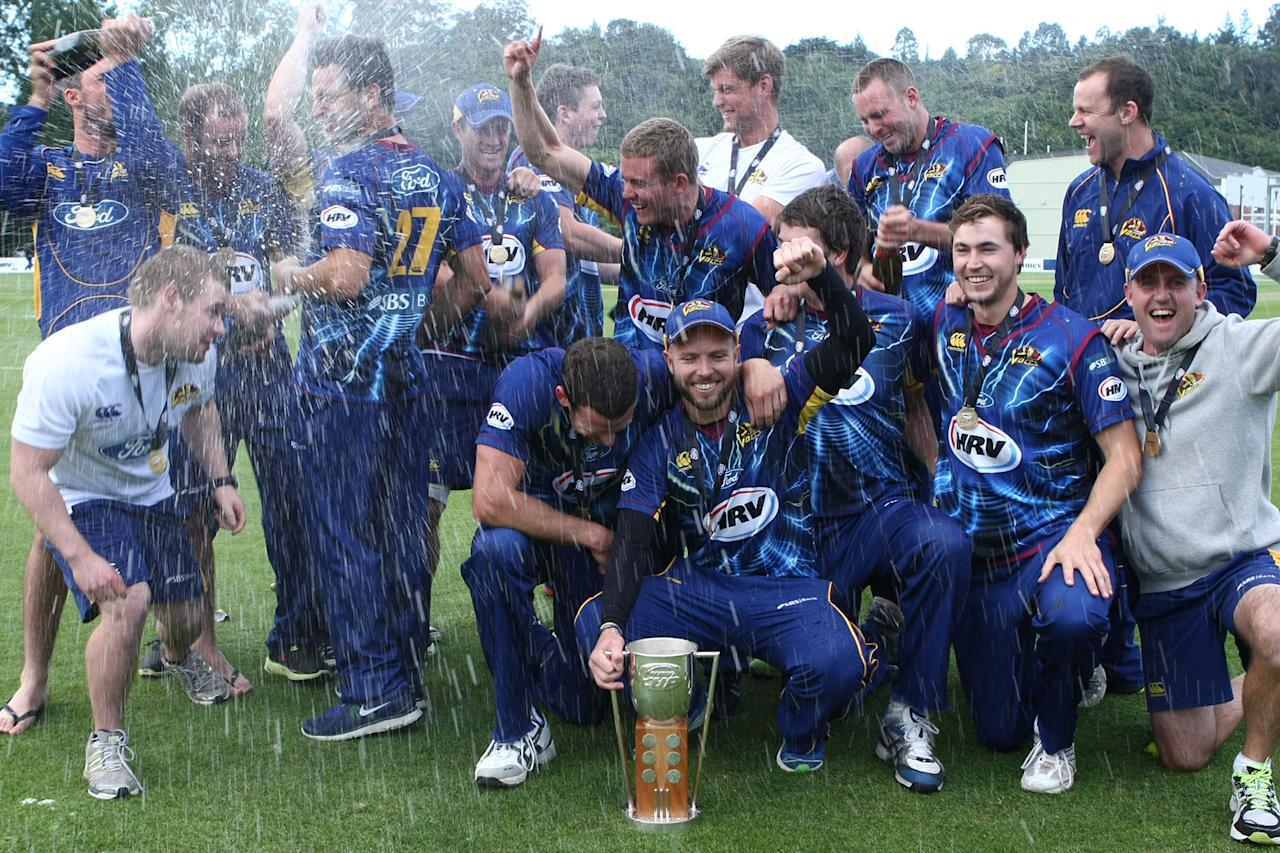 DUNEDIN, NEW ZEALAND - JANUARY 20:  Otago celebrates winning the HRV T20 Final match between the Otago Volts and the Wellington Firebirds at University Oval on January 20, 2013 in Dunedin, New Zealand.  (Photo by Teaukura Moetaua/Getty Images)
