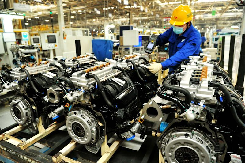 QINGDAO, CHINA - APRIL 30, 2020 - A worker of SAIC GM Wuling Automobile Co., Ltd. Qingdao branch is producing automobile engines on the production line. Qingdao, Shandong Province, China, April 30, 2020. China's Manufacturing Purchasing Managers Index (PMI) was 50.8% in April, according to the National Bureau of statistics.- PHOTOGRAPH BY Costfoto / Barcroft Studios / Future Publishing (Photo credit should read Costfoto/Barcroft Media via Getty Images)