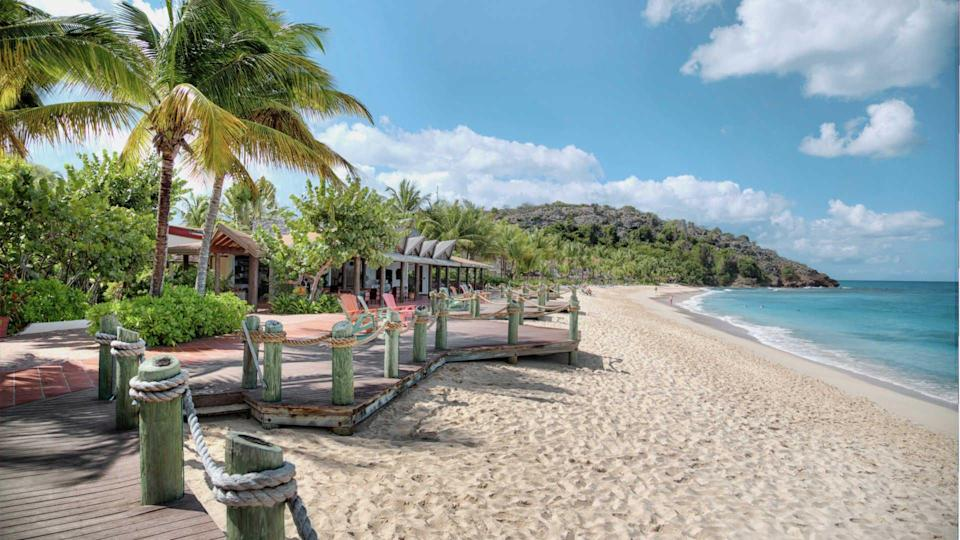 """<p><strong><a href=""""http://www.galleybayresort.com/uk/honeymoons.htm"""" rel=""""nofollow noopener"""" target=""""_blank"""" data-ylk=""""slk:Galley Bay Spa & Resort, Antigua"""" class=""""link rapid-noclick-resp"""">Galley Bay Spa & Resort, Antigua</a></strong><br>Honeymooning couples have the choice between two deluxe packages at this resort, depending on their needs: The """"romance"""" option includes a Champagne picnic on a secluded beach, while """"pampered"""" package includes a mani-pedi or facial. Whatever you choose, you'll be gifted a set of matching bath robes.</p><span class=""""copyright"""">Photo: Courtesy of Galley bay.</span>"""