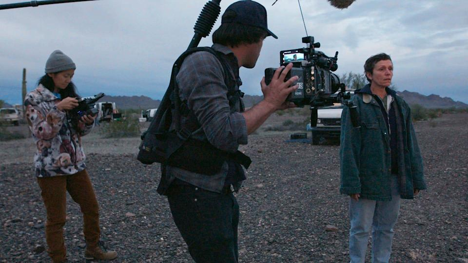 """Chloé Zhao, left, director of photography Joshua James Richards and actress Frances McDormand on the set of """"Nomadland."""""""