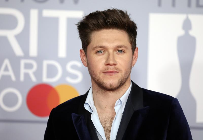 Niall Horan poses for photographers upon arrival at Brit Awards 2020 in London, Tuesday, Feb. 18, 2020.(Photo by Vianney Le Caer/Invision/AP)