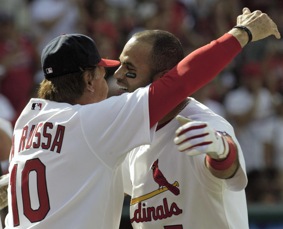 St. Louis Cardinals' Albert Pujols, right, embraces manager Tony La Russa after hitting a two-run walk-off home run in the ninth inning against the Cincinnati Reds in their baseball game Sunday, April 16, 2006, at Busch Stadium in St. Louis. Pujols hit three home runs as the Cardinals beat the Reds 8-7. (AP Photo/Tom Gannam)