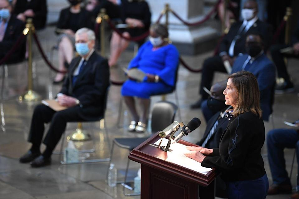 "<p>House Speaker Nancy Pelosi spoke at the beginning of the memorial service. ""John was revered and beloved on both sides of the aisle...God truly blessed America with the life and leadership of John Lewis,"" <a href=""https://abcnews.go.com/Politics/procession-begins-late-rep-john-lewis-lies-state/story?id=71999770"" rel=""nofollow noopener"" target=""_blank"" data-ylk=""slk:said"" class=""link rapid-noclick-resp"">said</a> Pelosi. </p>"