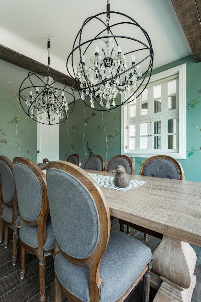 "The pastel-toned formal dining room features custom furniture by <a href=""https://fave.co/2PhLLYB"">Peacock Life</a> and chandeliers by <a href=""https://fave.co/33wvd3v"">The Kaleido Store</a> in Mumbai."