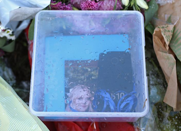 """Tributes, including a box containing a photograph of his wife Lissie and PC Harper's shoulder number, 510, left near the scene where Thames Valley Police officer Pc Andrew Harper, 28, died following a """"serious incident"""" at about 11.30pm on Thursday near the A4 Bath Road, between Reading and Newbury, at the village of Sulhamstead in Berkshire."""