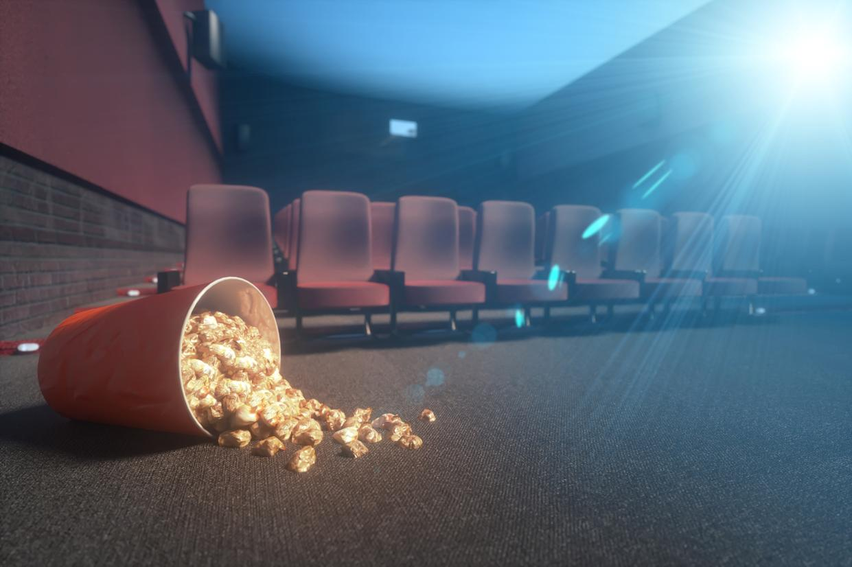 fallen bucket of popcorn in an abandoned movie theater, during the epidemic of the coronavirus 3d render