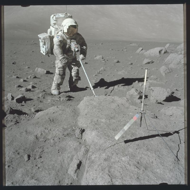 Scientist-astronaut Harrison Schmitt, Apollo 17 lunar module pilot, uses an adjustable sampling scoop to retrieve lunar samples during the second Apollo 17 extravehicular activity in this December 12, 1972 NASA handout photo. The photograph is one of more than 12,000 from NASA's archives recently aggregated on the Project Apollo Archive Flickr account. REUTERS/NASA/Handout via Reuters THIS IMAGE HAS BEEN SUPPLIED BY A THIRD PARTY. IT IS DISTRIBUTED, EXACTLY AS RECEIVED BY REUTERS, AS A SERVICE TO CLIENTS. FOR EDITORIAL USE ONLY. NOT FOR SALE FOR MARKETING OR ADVERTISING CAMPAIGNS
