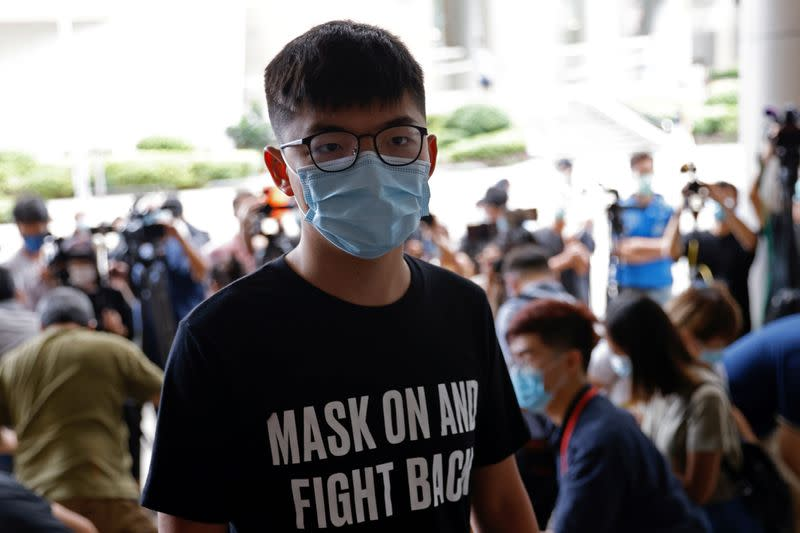 Pro-democracy activist Joshua Wong arrives at the Eastern Magistrates' Courts over illegal assembly and violation of an emergency law banning face coverings last year, in Hong Kong