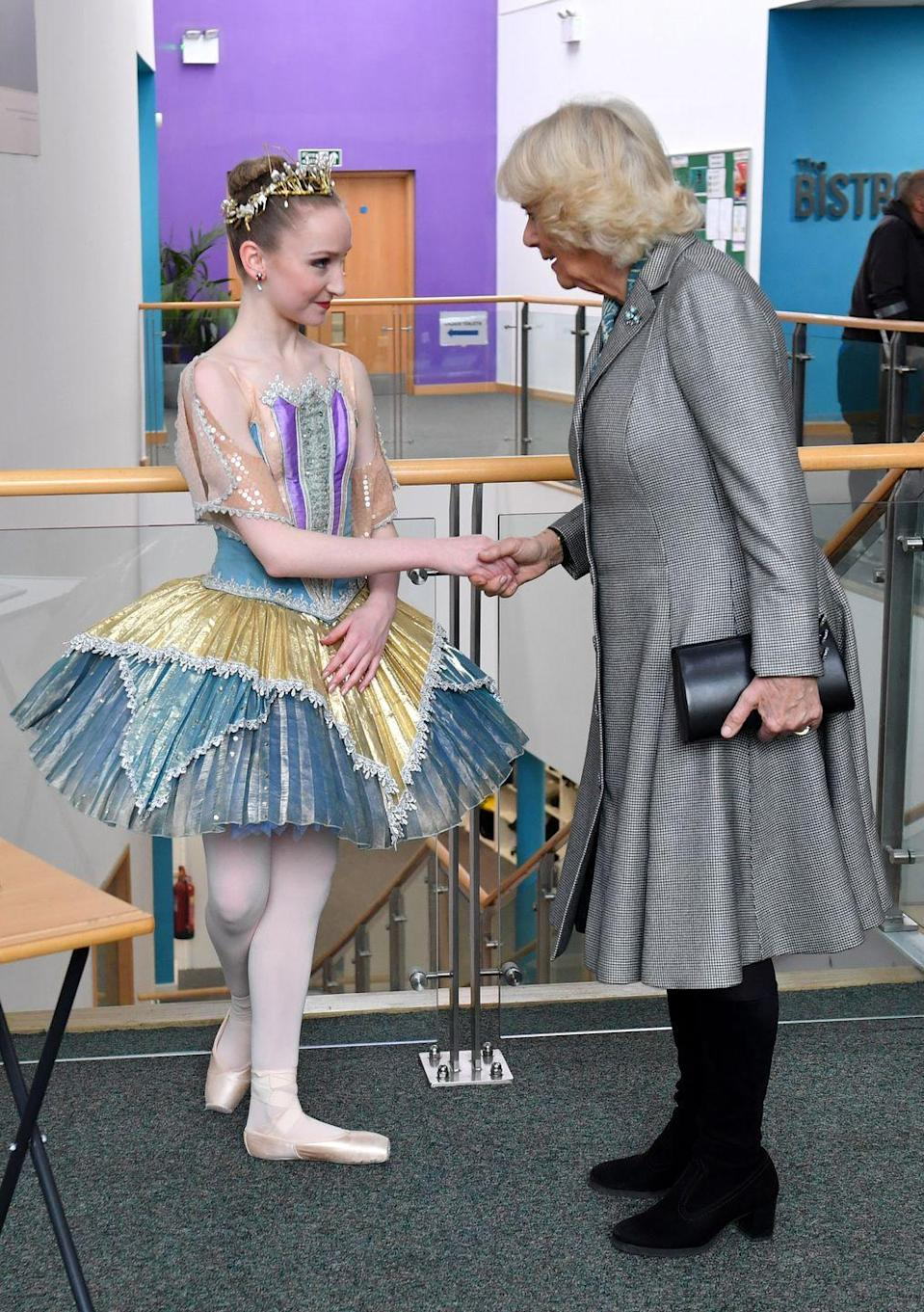 <p>Camilla meets a young dancer during her visit to Elmhurst Ballet School in Birmingham, of which she is a patron.</p>