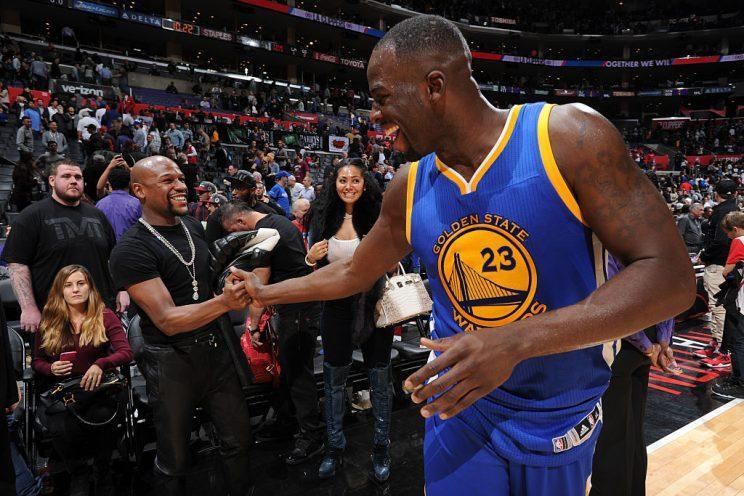 Draymond Green greets Floyd Mayweather at STAPLES Center after a Nov. 19, 2015, game. (Andrew D. Bernstein/NBAE/Getty Images)