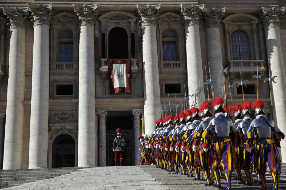 Swiss Guards march in front of Peter's Basilica at the Vatican, Tuesday, Dec. 25, 2018. Monday's late night Mass was the first major event of the Christmas season, followed by Francis' noon Urbi et Orbi (To the city and the world) blessing on Christmas day. (AP Photo/Alessandra Tarantino)