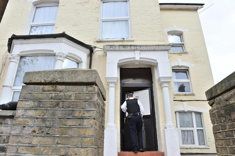 A police officer enters in the address in Wilberforce Road (PA)