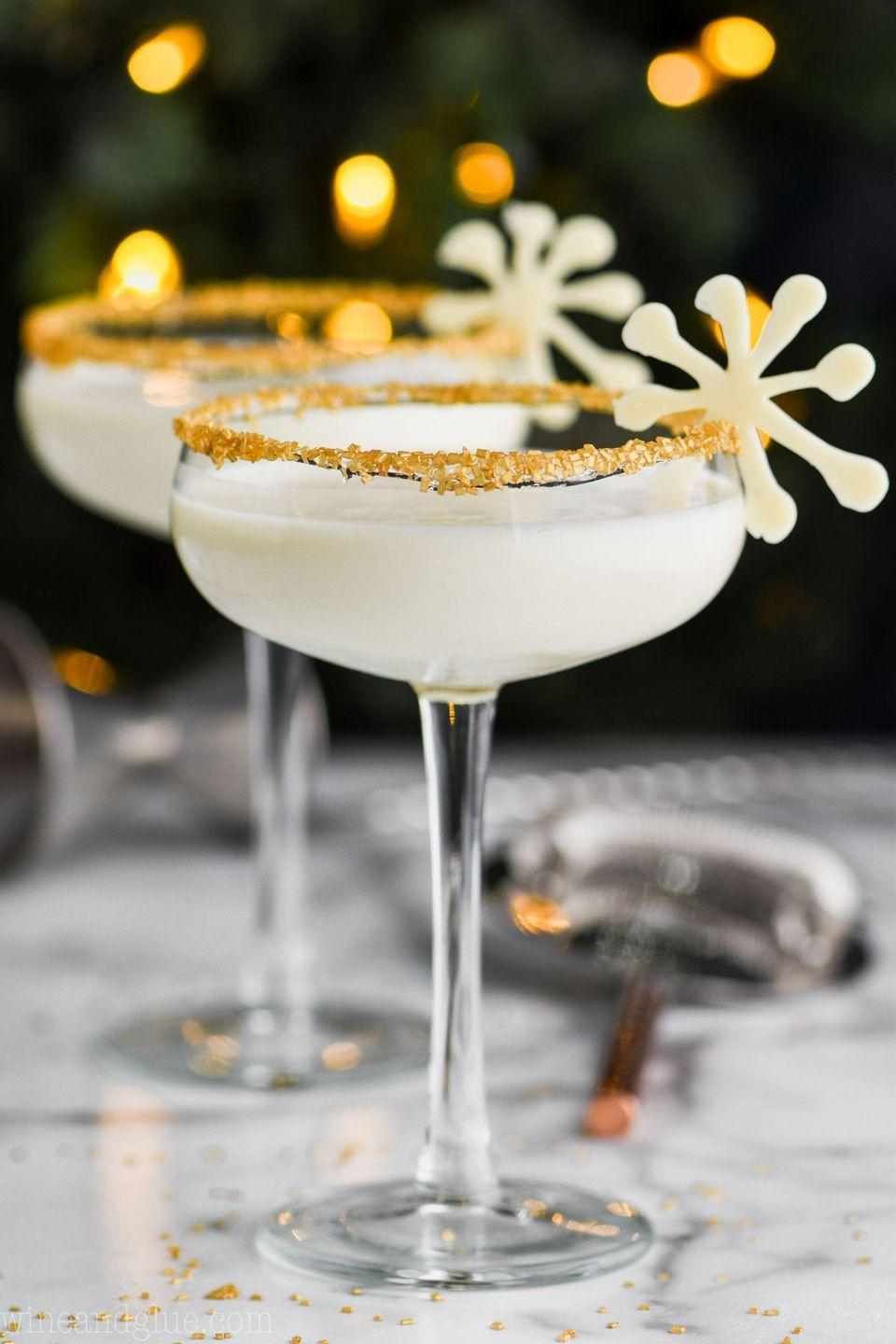 "<p>One sip of this rummy vanilla cocktail and you'll be singing <a href=""https://www.youtube.com/watch?v=IOkyBqGw2Wg"" rel=""nofollow noopener"" target=""_blank"" data-ylk=""slk:the song"" class=""link rapid-noclick-resp"">the song</a> right along with Bing Crosby.</p><p><strong>Get the recipe at <a href=""https://www.simplejoy.com/white-christmas-martini/"" rel=""nofollow noopener"" target=""_blank"" data-ylk=""slk:Simple Joy"" class=""link rapid-noclick-resp"">Simple Joy</a>.</strong></p>"