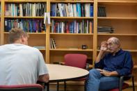 Michael Oppenheimer speaks with a student in his office at Princeton University