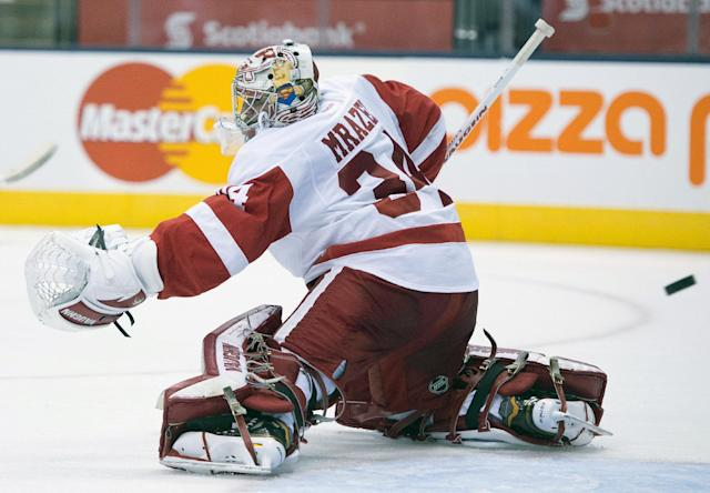 Detroit Red Wings goaltender Petr Mrazek goes to his knees to make a save as the puck gets past him during second-period preseason NHL hockey game action against the Toronto Maple Leafs in Toronto, Saturday Sept. 28, 2013. (AP Photo/The Canadian Press, Frank Gunn)