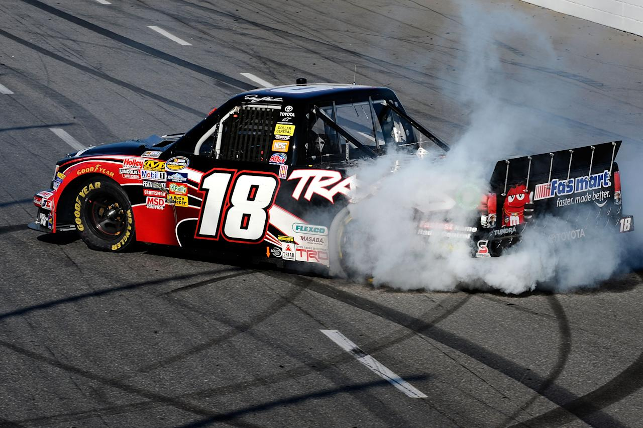 MARTINSVILLE, VA - OCTOBER 29:  Denny Hamlin, driver of the #18 Toyota/Traxxas Toyota, celebrates with a burnout after winning the NASCAR Camping World Truck Series Kroger 200 at Martinsville Speedway on October 29, 2011 in Martinsville, Virginia.  (Photo by Jared C. Tilton/Getty Images)